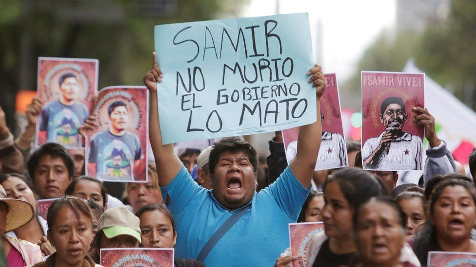 """A man holds up a placard reading """"Samir didn""""t die, the government killed him"""" during a protest to demand justice for Mexican activist Samir Flores Soberanes in Mexico City, Mexico February 22, 2019"""