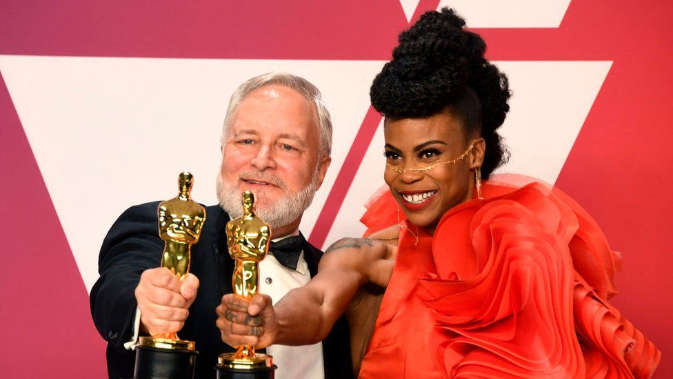 Jay Hart and Hannah Beachler, winners of Best Production Design for 'Black Panther,' pose in the press room during the 91st Annual Academy Awards at Hollywood