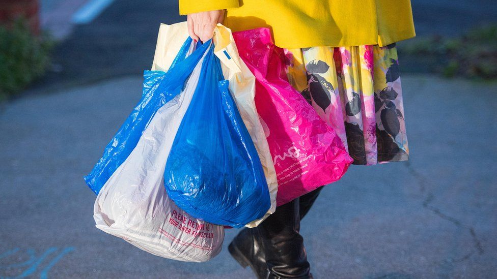 woman with carrier bags