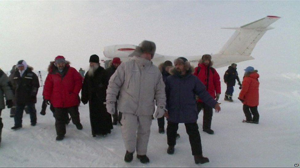 Dmitry Rogozin with group in Arctic (screengrab - APTN)
