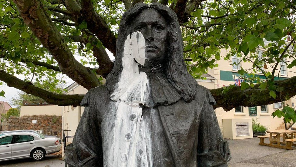 White paint on face and body of Sir George Carteret statue