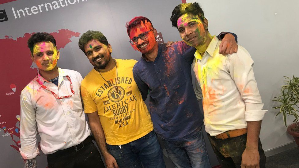 BBC reporters covered in paint