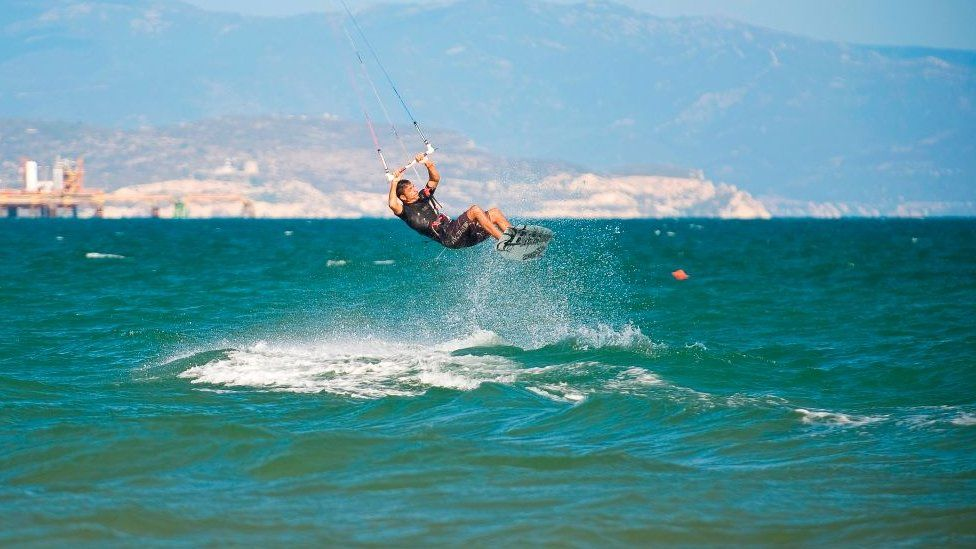 Someone kitesurfing