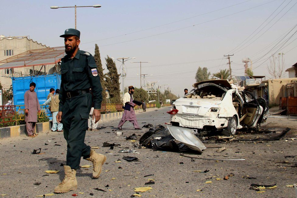 Afghan security officials inspect the scene of a IED blast in Lashkargah, the provincial capital of Helmand, Afghanistan, 12 November 2020.