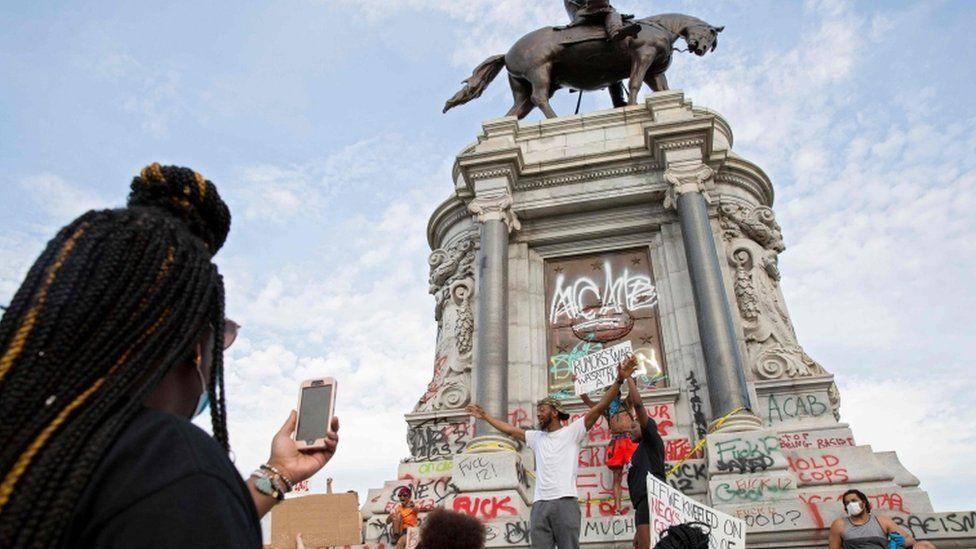 Protesters gather at a Confederate statue in Richmond