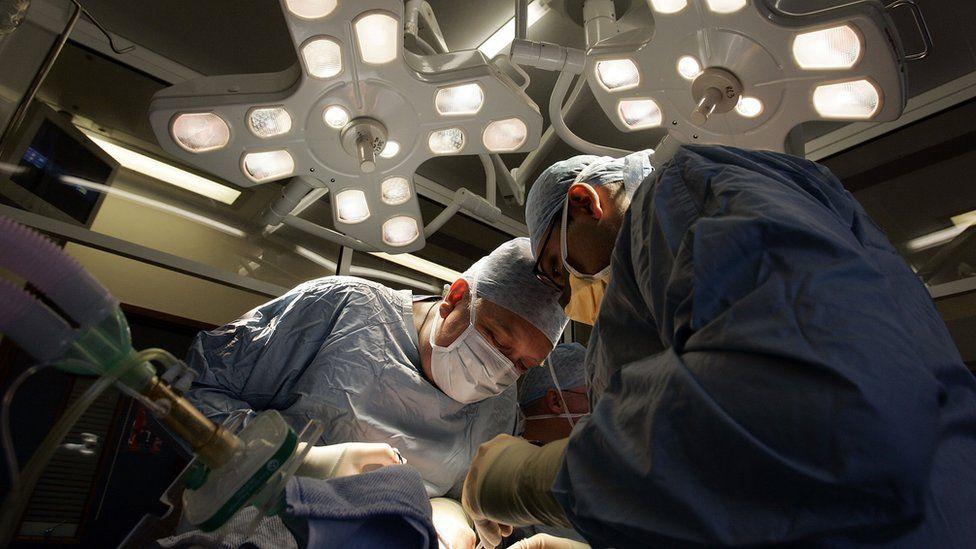 Surgeons perform a kidney transplant