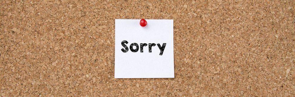 sorry note on corkboard