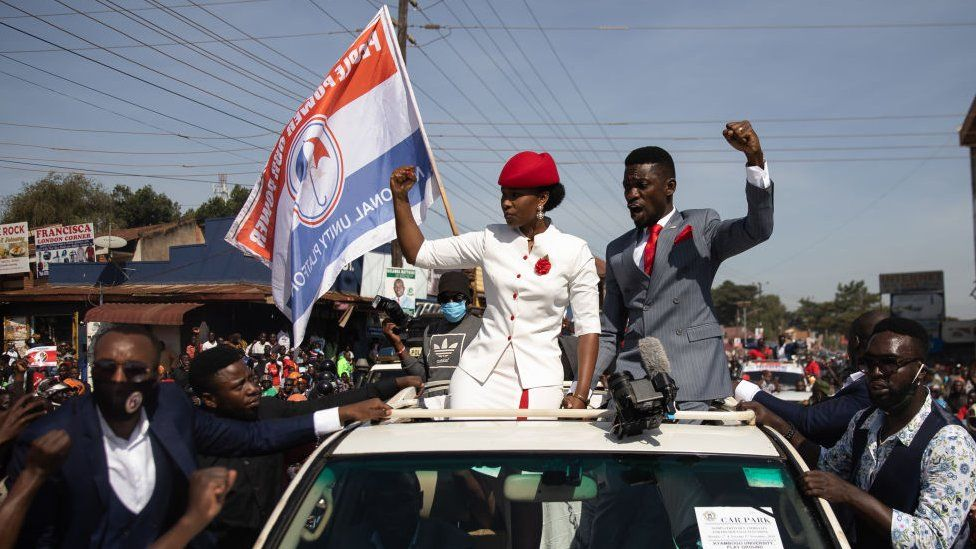 Bobi Wine parades though the streets through crowds of supporters