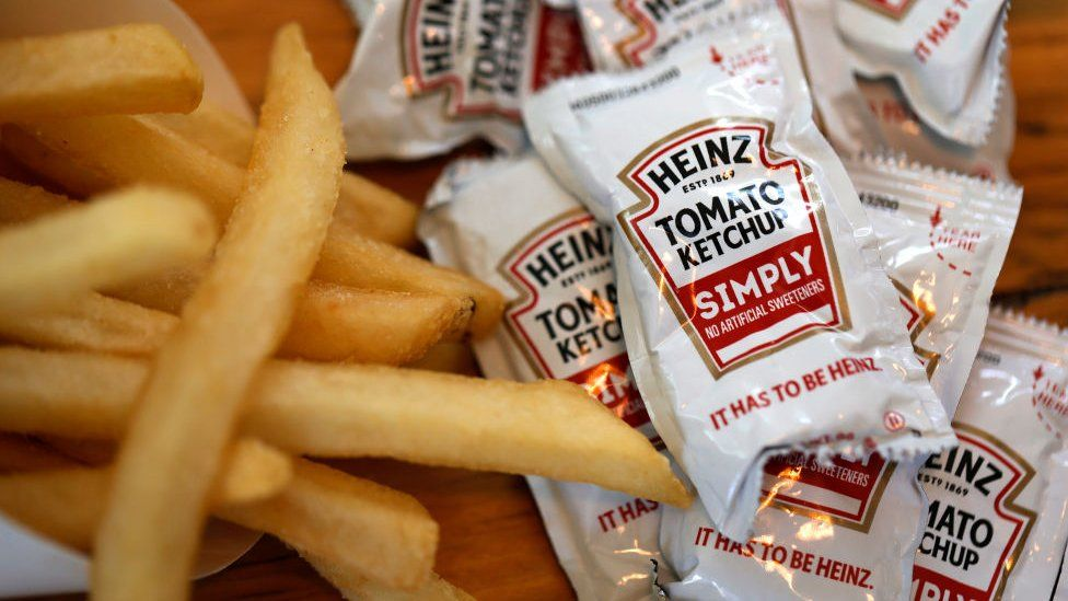 Sachets of Heinz ketchup with french fries