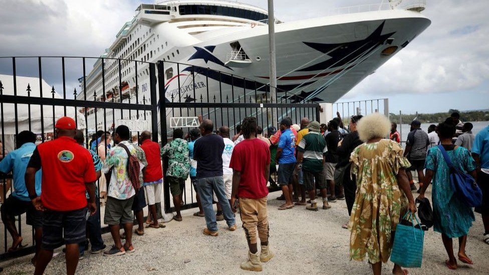 Local workers waiting for a cruise ship in Vanuatu in December 2019 - something that cannot happen while borders are closed