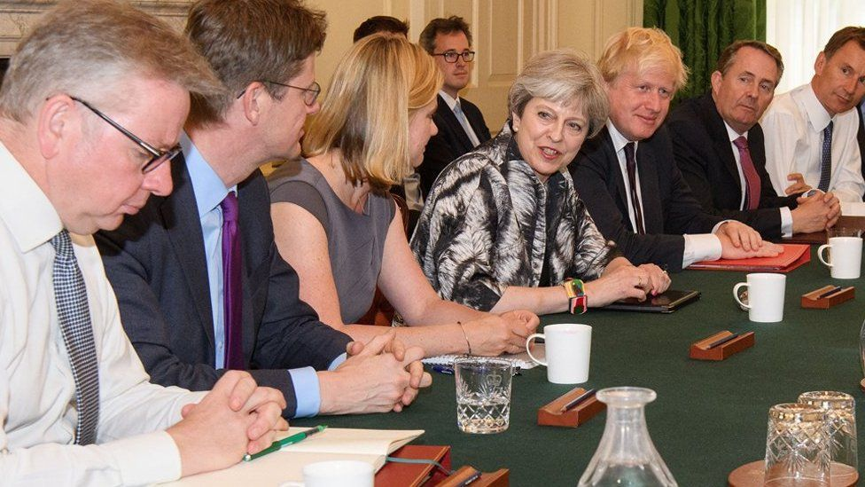 Theresa May chairs a meeting of her cabinet in July
