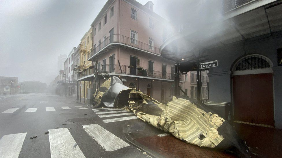 A building's roof is blown off in the French Quarter of New Orleans