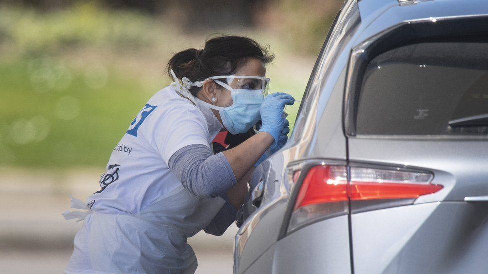 Tests being carried out at a coronavirus testing site in a car park in London