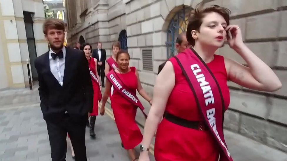 Climate change protesters on their way into Mansion House