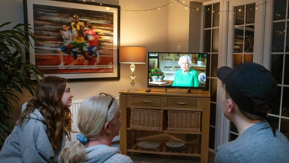A family watching the Queen's coronavirus speech on TV