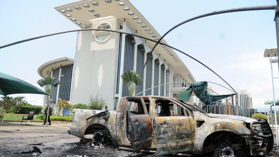 Burned-out cars outside government building in Libreville, Gabon, Sept 1, 2016