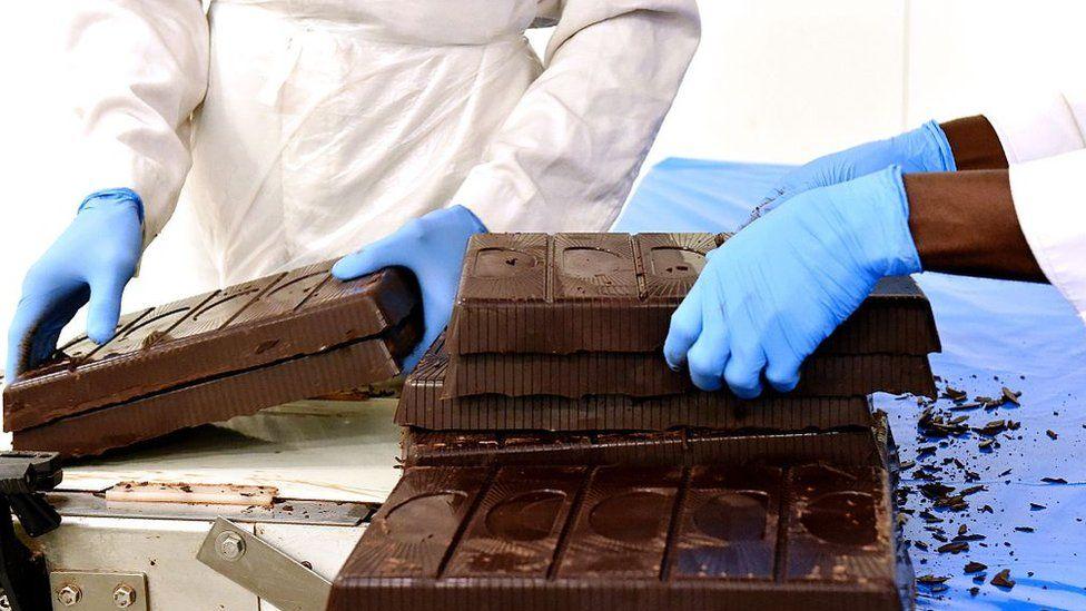 Huge bars of chocolate being set in an Abidjan chocolate factory