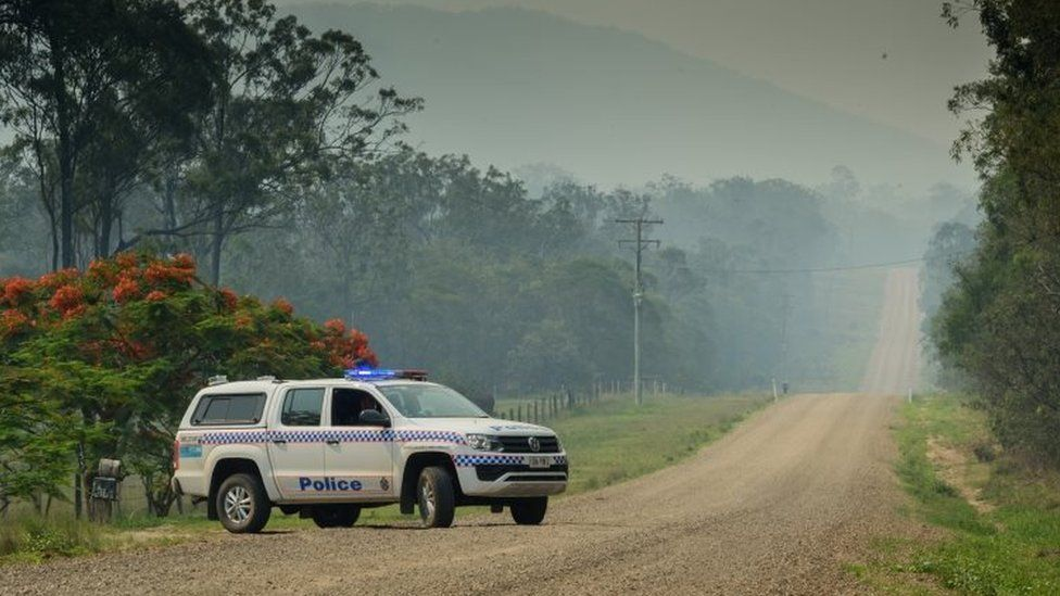 Police block off road to check houses in area affected