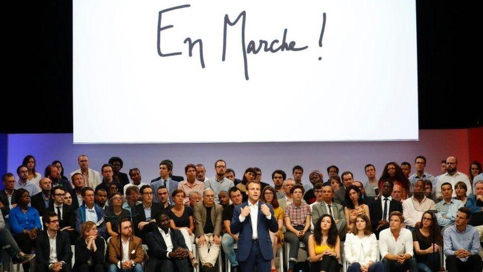 """Emmanuel Macron (C) speaks during a public meeting of his political movement """"En Marche"""""""