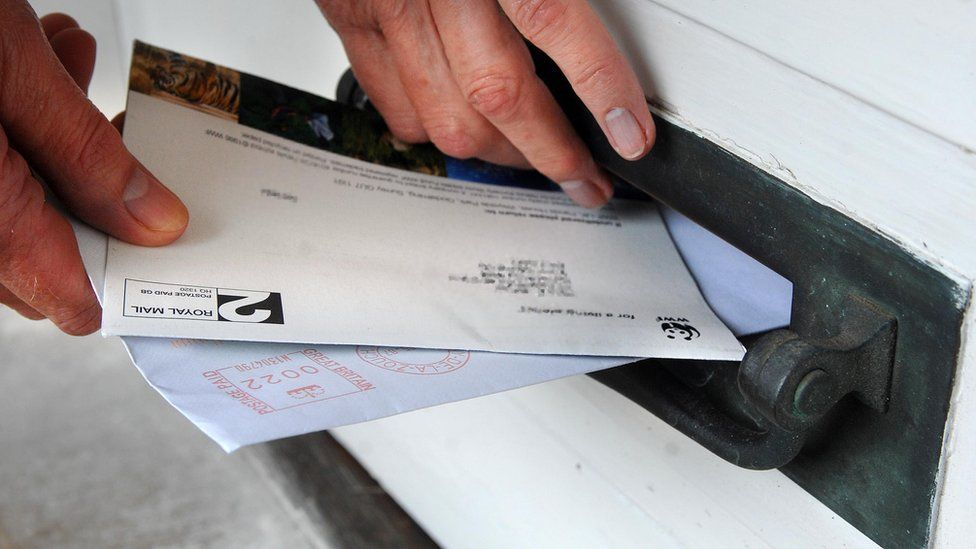 A generic image of post being delivered through a letterbox.