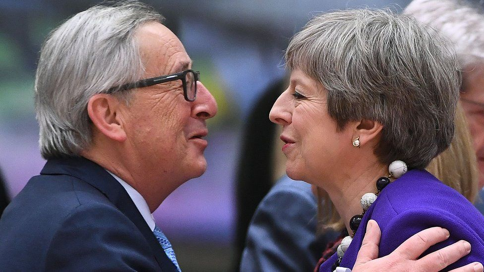 Britain's Prime minister Theresa May greets European Commission President Jean-Claude Juncker (L) as they attend a European leaders summit at the European Council in Brussels on March 22, 2018.
