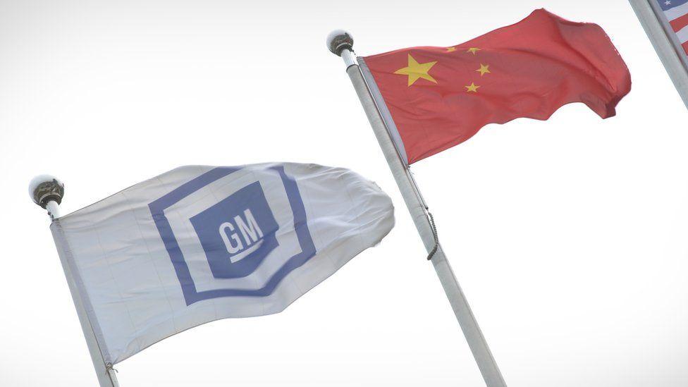 GM flag alongside China flag