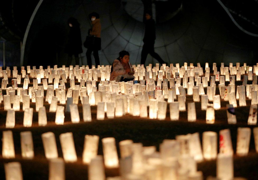 Paper lanterns are lit for the victims on the anniversary of the earthquake and tsunami disaster. Tokyo, Japan, 11 March 2021