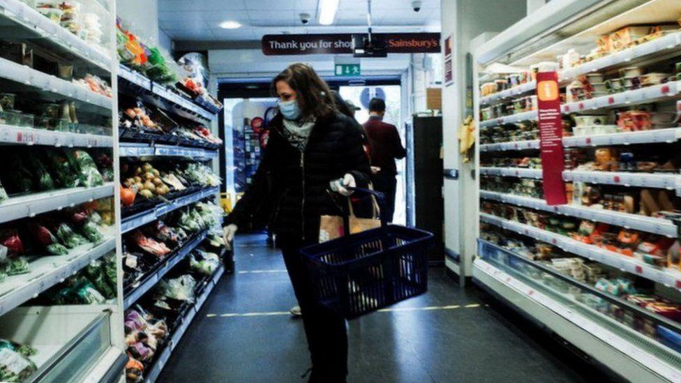 A shopper in Sainsbury's