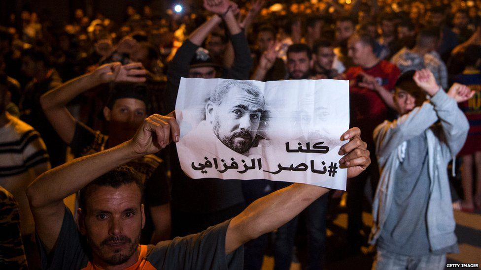 Protesters holding an image of Zefzafi