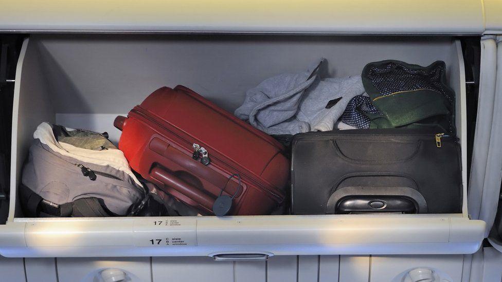 bags in overhead locker