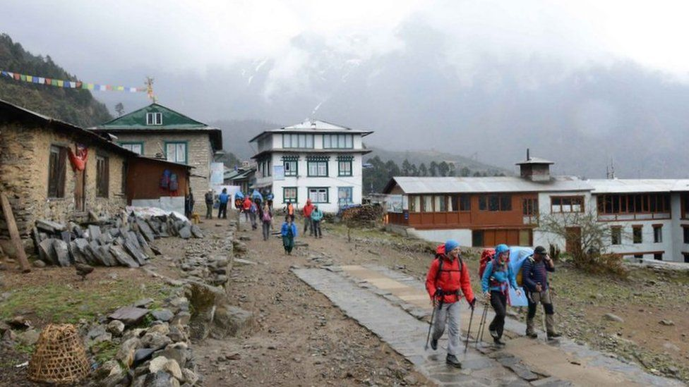 Two climbers set off with their guide towards Everest Base Camp