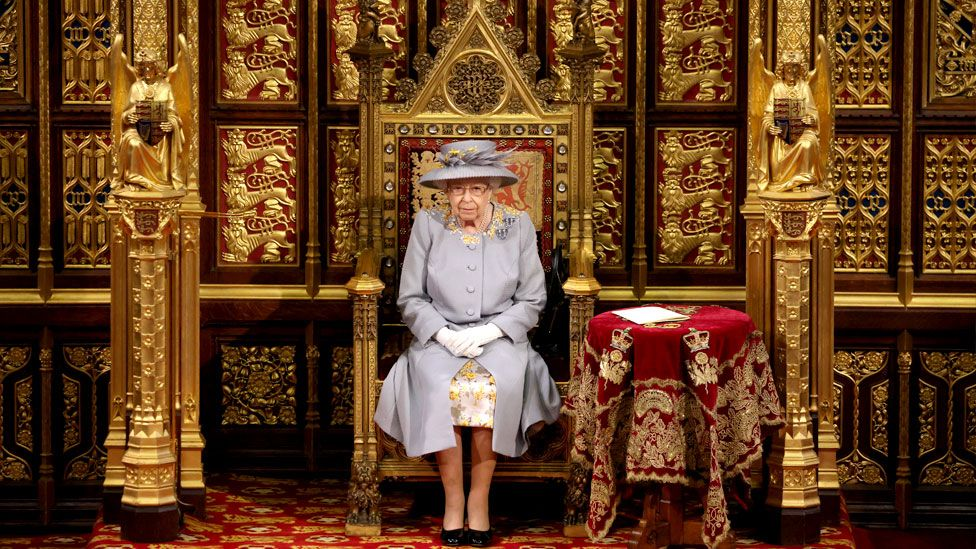 Queen Elizabeth II sits on the Great Throne in the House of Lords