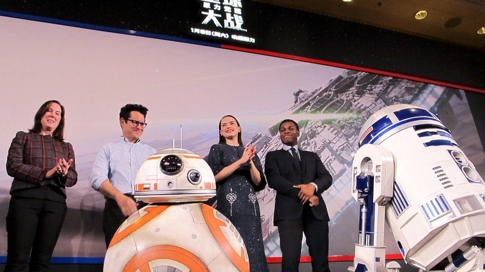 Producer Kathleen Kennedy, director J.J. Abrams, actress Daisy Ridley and actor John Boyega on stage at a press conference in Shanghai, China