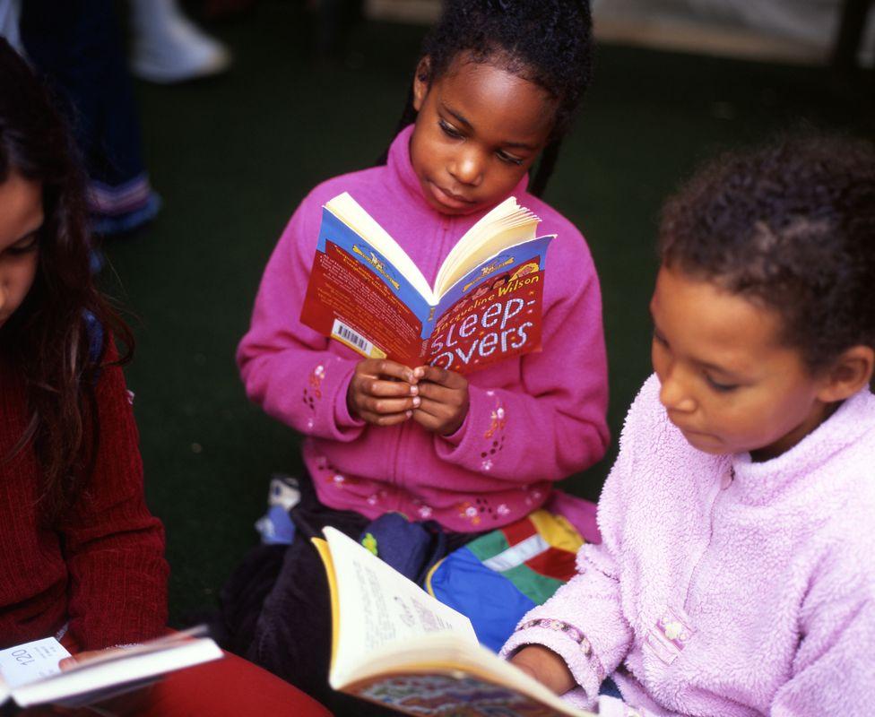 Girls reading Jacqueline Wilson books at the Hay festival