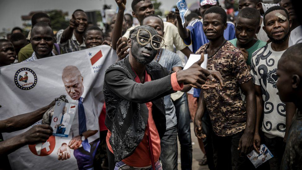 Supporters of opposition leader Martin Fayulu sing and dance as they march and chant slogans in the streets of the Ndjili district of Kinshasa on 19 December 2018