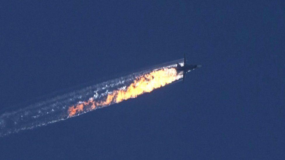 A Russian warplane on fire in mid air