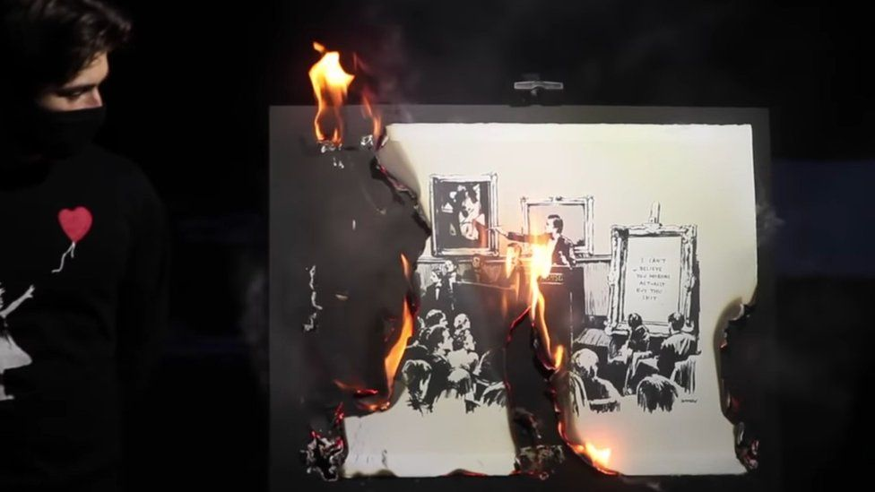 Screenshot from video of Banksy art being burnt