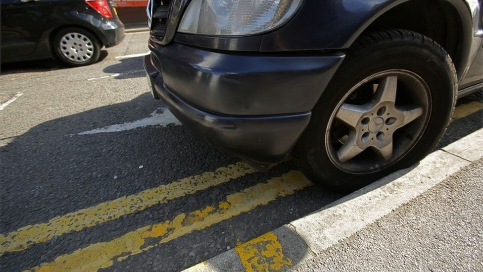 Car parked on double yellow lines