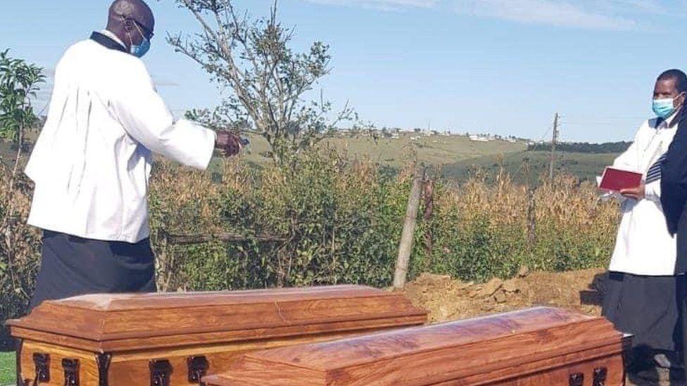 Priest presiding over a funeral