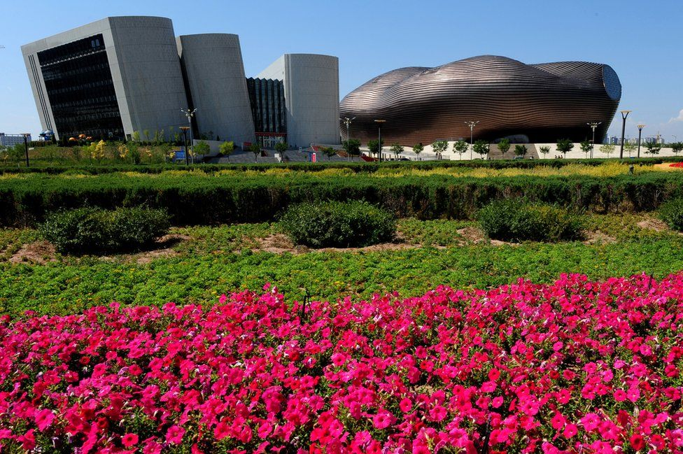 A general view shows the City Library (left) and the Ordos Museum building in the city centre of Ordos