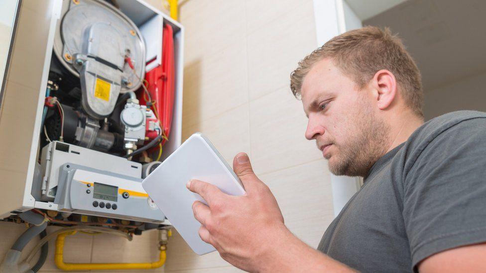 Technician repairing gas boiler