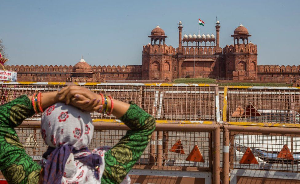 An Indian tourist disappointed to see the Red Fort, closed for tourists to prevent spread of Covid-19, as she look towards the ford on March 17, 2020 in New Delhi, India.