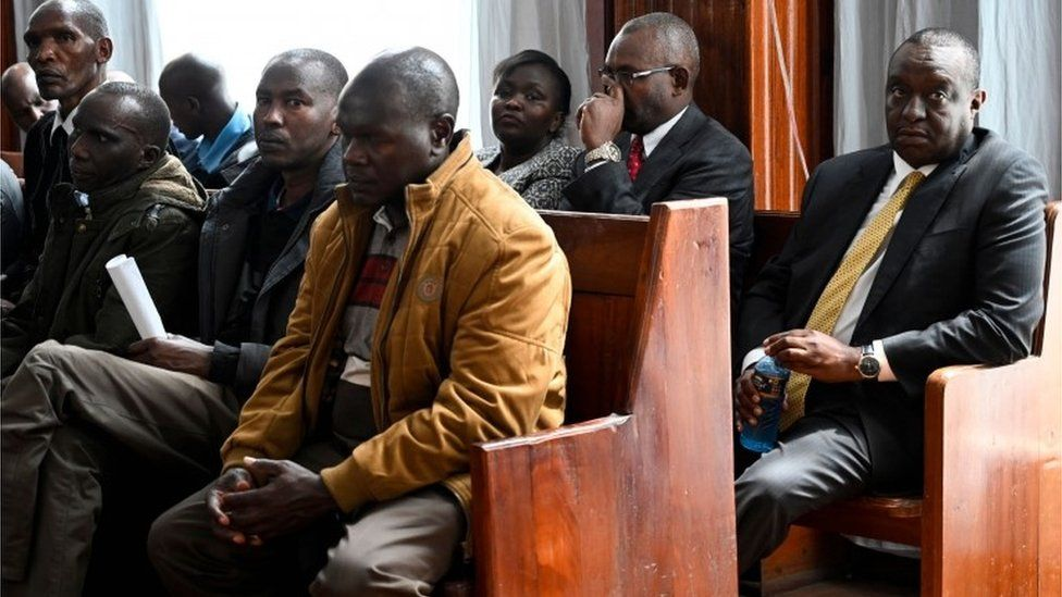 Henry Rotich (R back row) sits at the Milimani Law Court in Nairobi as he attends an hearing to face corruption charges, on July 23, 2019