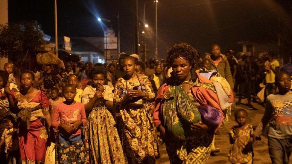 Goma residents are seen leaving the city following a sudden activity of the Nyiragongo volcano