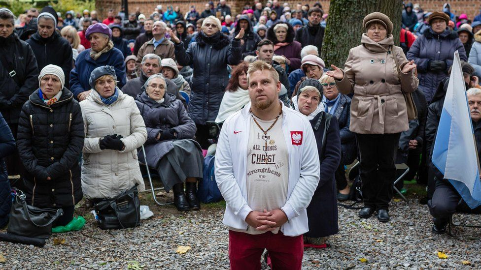 People pray on Poland's eastern border with Belarus
