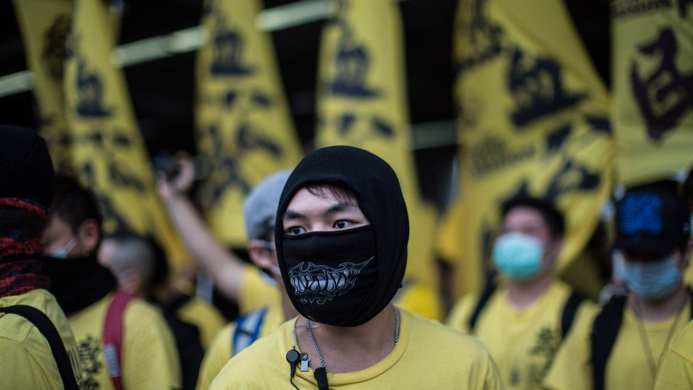 A member of the Civic Passion group looks on as he and other members attend an anti-parallel trading protest in the Yuen Long district of Hong Kong on March 1, 2015