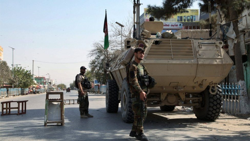 Members of the Afghan security forces stand guard at a check point on a roadside in Kunduz, Afghanistan, 07 October 2015.