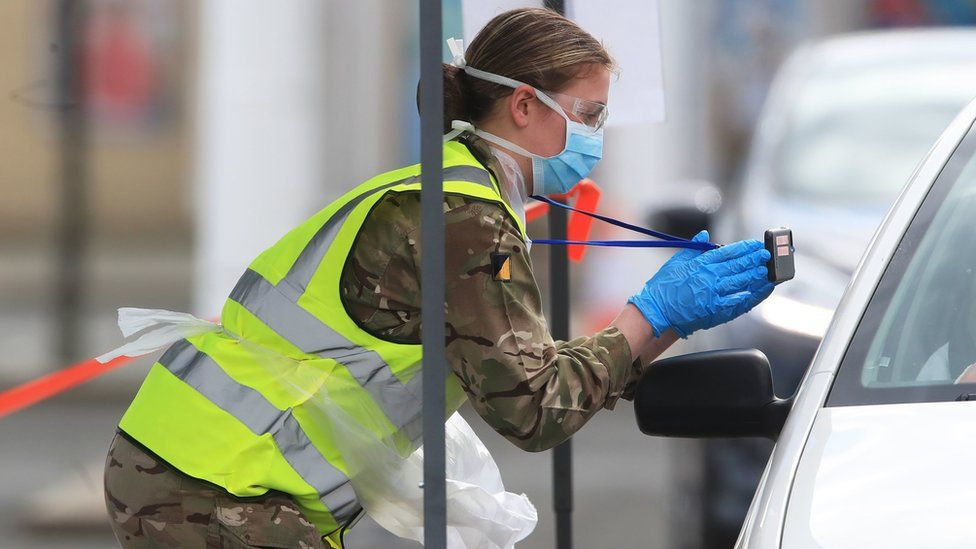 A soldier carries out a test