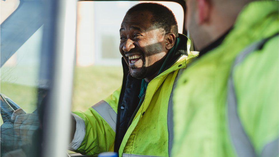 Workers in van