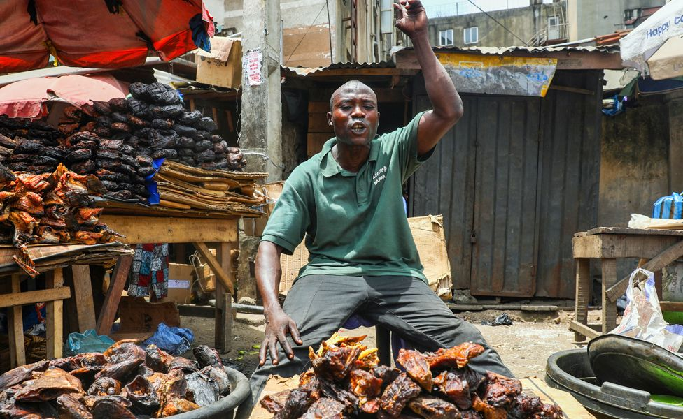 A fisher seller at a market in Lagos, Nigeria - Monday 30 March 2020